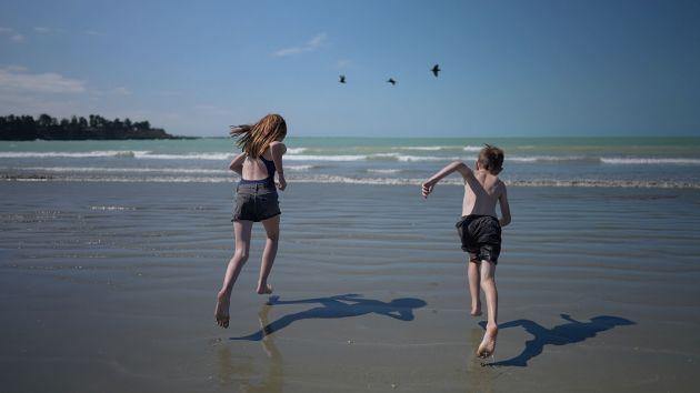 Kids running on Caroline Bay